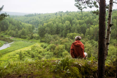 Caucasian man admiring scenic view from rural hilltop - BLEF08126