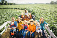 Caucasian family smiling on hay ride - BLEF08201