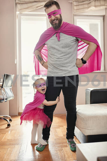 Father and daughter playing super hero and superwoman - ZEDF02493