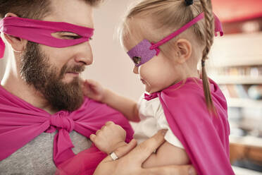 Father and daughter playing super hero and superwoman - ZEDF02508