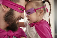 Father and daughter playing super hero and superwoman - ZEDF02511