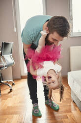 Father and daughter playing at home - ZEDF02520