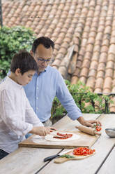 Father and son preparing pizza together - ALBF00916