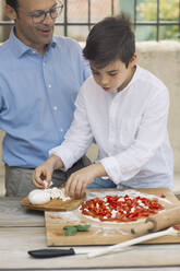 Father and son preparing pizza together - ALBF00922