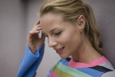 Portrait of beautiful blond woman, wearing striped pullover - JOSF03366