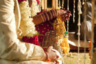 Couple in ornate, traditional Indian wedding clothing - BLEF08410