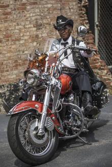 Senior African American man riding motorcycle - BLEF08654
