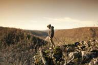 Mari man overlooking rural landscape - BLEF08684