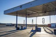 Empty gas station in remote landscape - BLEF08699