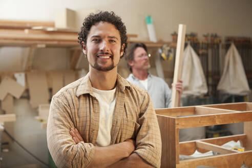 Co-workers woodworking in workshop - BLEF08817