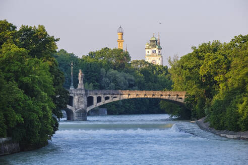 Germany, Upper Bavaria, Munich, Maximiliansbrucke crossing Isar river with Muffatwerk and Mullersches Volksbad towers in background - SIEF08752