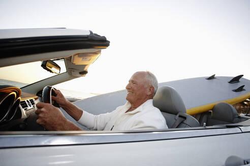 Caucasian man driving convertible - BLEF09011