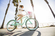 Caucasian woman riding bicycle - BLEF09068