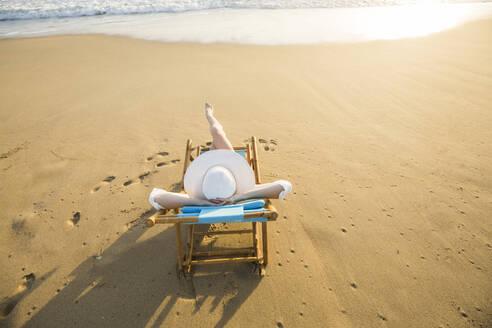 Caucasian woman laying on beach - BLEF09083