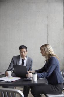 Business people meeting, working at laptop - HEROF36998