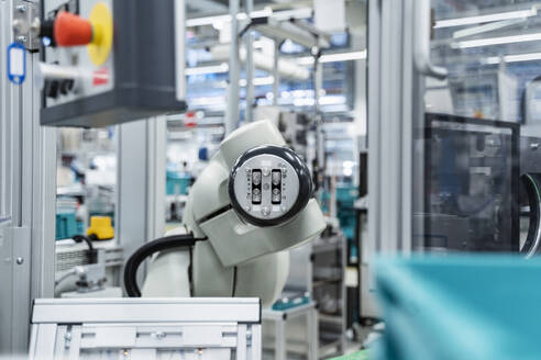 Arm of assembly robot functioning inside modern factory, Stuttgart, Germany - DIGF07177