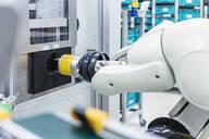 Arm of assembly robot functioning inside modern factory, Stuttgart, Germany - DIGF07198