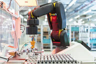 Arm of assembly robotpickingup machine part, Stuttgart, Germany - DIGF07204