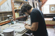 Sculptor working on an object - VPIF01289