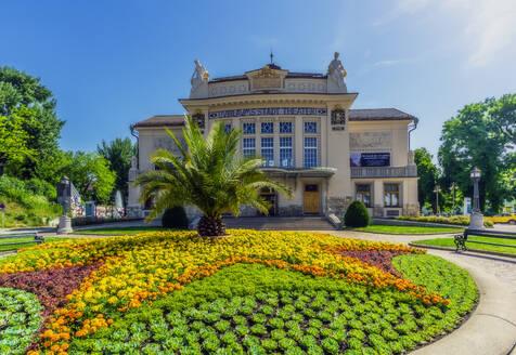 Austria, Carinthia, Klagenfurt, Stadttheater Klagenfurt with flowerbed in foreground - THAF02516
