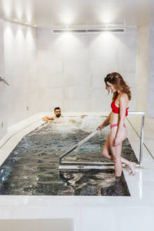 Man and woman enjoying the whirlpool in a spa - LJF00396