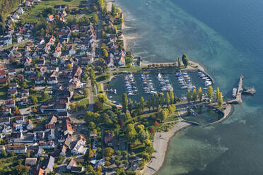Germany, Baden-Wurttemberg, Aerial view of town and marina on lake Constance - SHF02198