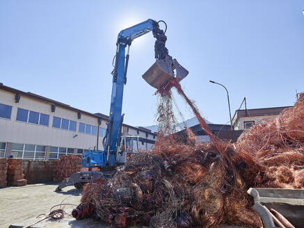 Austria, Tyrol, Brixlegg, Electronic copper wires being recycled in junkyard - CVF01254