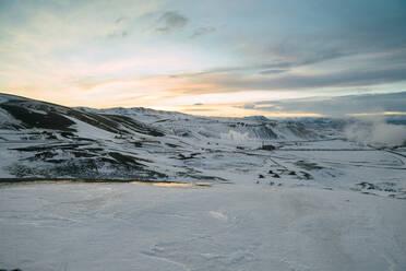 Iceland, frozen river near Krafla region before sunset - TAMF01749