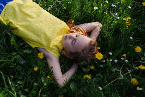 Girl relaxing on flower meadow - OGF00027