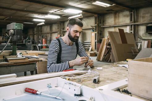 Russia, Amur, Blagoveschensk, carpenter, furniture, team, business - VPIF01349