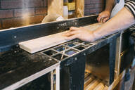 Carpenter at work on a saw - VPIF01355