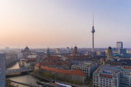 High angle view of Fernsehturm in Berlin against sky during sunset - TAMF01776
