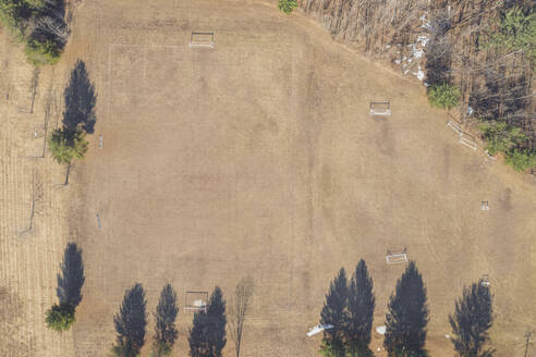Aerial view of dry soccer field in summer during drought - MMAF01086