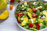 Close-up of fresh salad in bowl on table - SARF04331