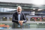 Portrait of mature businessman at the station platform - DIGF07457