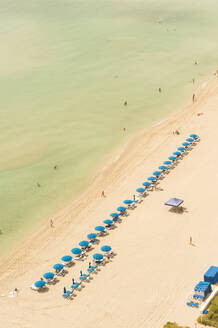 Aerial view of lawn chairs on beach - BLEF09715