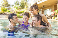 Couples talking in swimming pool - BLEF09718