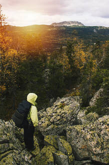 High angle view of hiker on remote mountaintop, Ural, Ural, Russia - BLEF09787