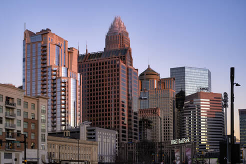 Low angle view of skyscrapers in Charlotte against clear sky during sunset - LOM00881