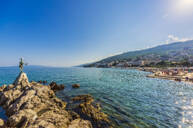 Opatija town at coast of Adriatic Sea against blue sky during sunny day - THAF02545