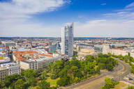 High angle view of City-Hochhaus in Leipzig cityscape against cloudy sky - TAMF01825