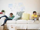 Angry boys sitting on sofa - BLEF10126