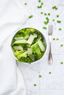 Directly above view of fresh salad in bowls by napkin and forks - LVF08188