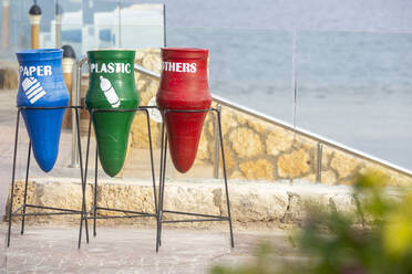 Garbage bins with text at beach in city - NGF00508