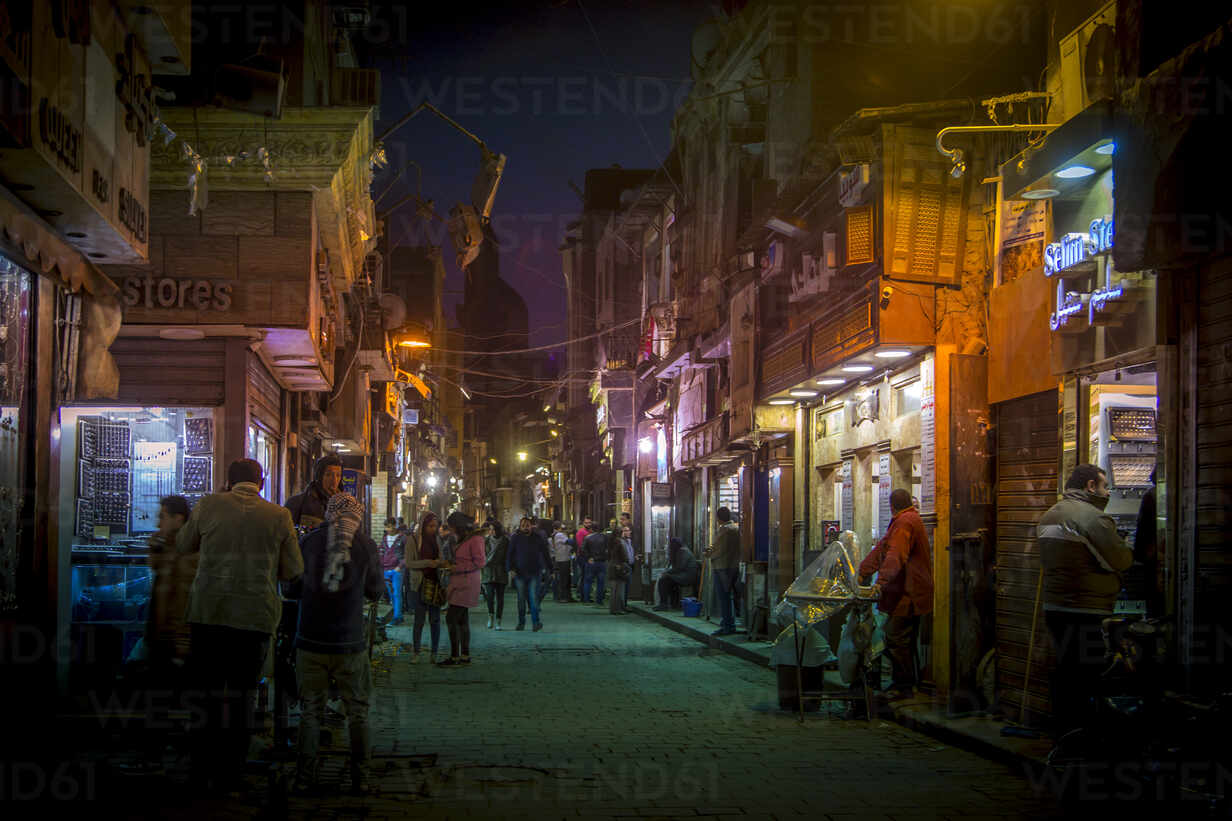 People on illuminated street amidst buildings in Cairo city at night - NG00517 - Nadine Ginzel/Westend61