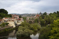 Bridge over river canal by buildings in town at Duoro Valley against cloudy sky - FCF01751