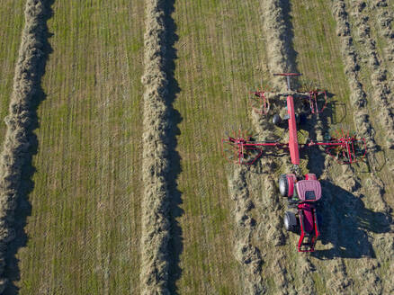 Tractor Turning Grass To Dry And Make Into Hay - JUIF02420