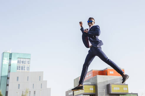 Young businessman jumping mid-air - LJF00465