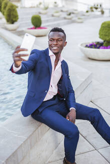 Young businessman taking a selfie - LJF00471