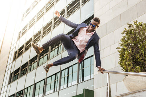 Young businessman jumping mid-air - LJF00483